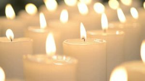 stock-footage-white-candles-burning-peacefully-middle-candle-in-focus-other-candles-out-of-focus
